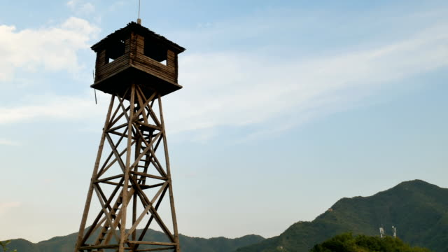wooden watchtower aginst the sky. - barracks stock videos & royalty-free footage
