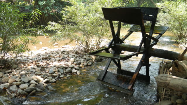 wooden water turbine in the river - water wheel stock videos and b-roll footage