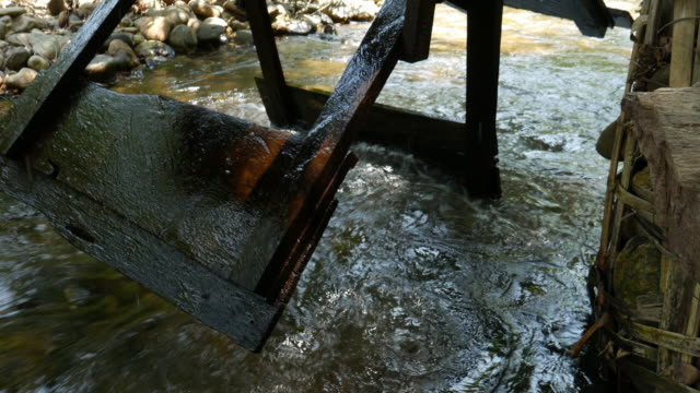wooden water turbine in the river - watermill stock videos and b-roll footage
