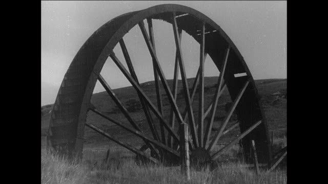 montage wooden waterwheel on countryside farm / aberystwyth, wales - water wheel stock videos and b-roll footage