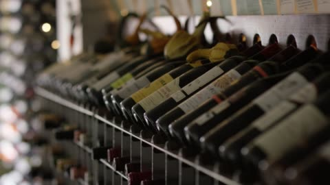 wooden wine rack with an assortment of wines decorated with gourds selective focus - shelf stock videos & royalty-free footage