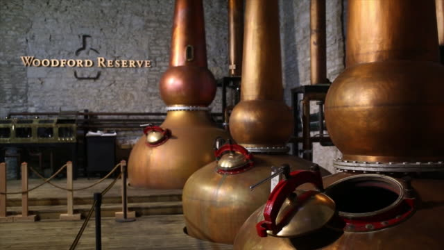 woodford reserve bourbon whiskey is produced at the brownforman corp woodford reserve bourbon distillery in versailles kentucky us on thursday august... - distillery still stock videos & royalty-free footage