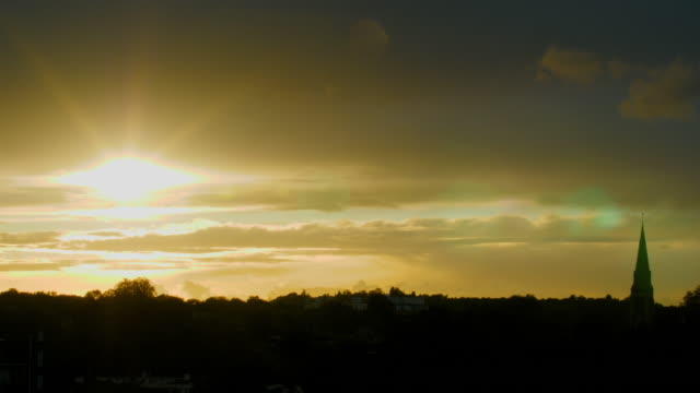 ws woodland and church spire at sunset - pinnacle stock videos & royalty-free footage