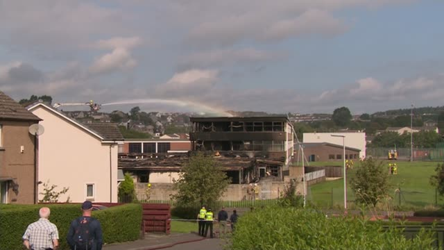 14yearold boy arrested scotland dunfermline woodmill high school ext burnt out school buildings with fire fighters at work in on burnt out building - dunfermline stock videos & royalty-free footage