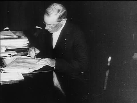 vídeos y material grabado en eventos de stock de woodrow wilson signing declaration of war / documentary - woodrow wilson
