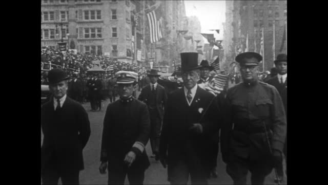 woodrow wilson stands talking with group of men in top hats and overcoats, location unknown / wilson carrying a us flag marches at the head of a war... - new york city 1910s stock videos & royalty-free footage