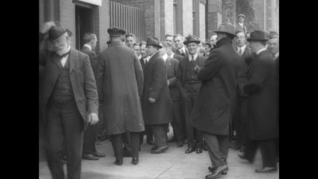 stockvideo's en b-roll-footage met woodrow wilson wearing newsboy cap exits car greets man enters polling place he exits tips hat and enters car // charles evans hughes walks on... - woodrow wilson