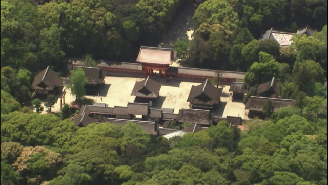 Woods surround the Upper Kamo Shrine in Kyoto, Japan, with the city sprawling beyond.