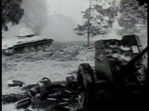 woods w/ tanks moving through over trees dead german nazi soldiers fg. dead soldier by artillery. soviet tank behind trees inside russian tank... - tank stock videos & royalty-free footage