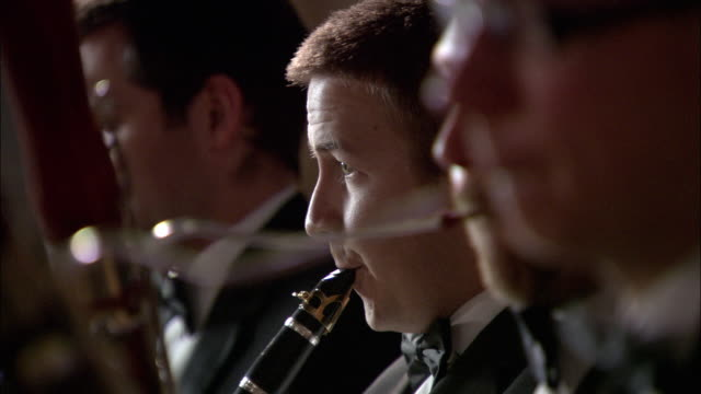 cu r/f woodwind players performing in orchestra / london, united kingdom - orchester stock-videos und b-roll-filmmaterial