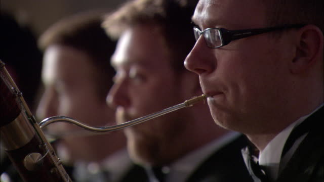 cu r/f woodwind players performing in orchestra / london, united kingdom - stoppelbart stock-videos und b-roll-filmmaterial