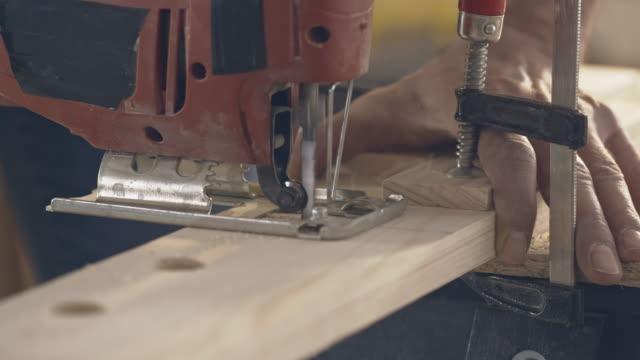 Woodwork, Carpenter sawing wood