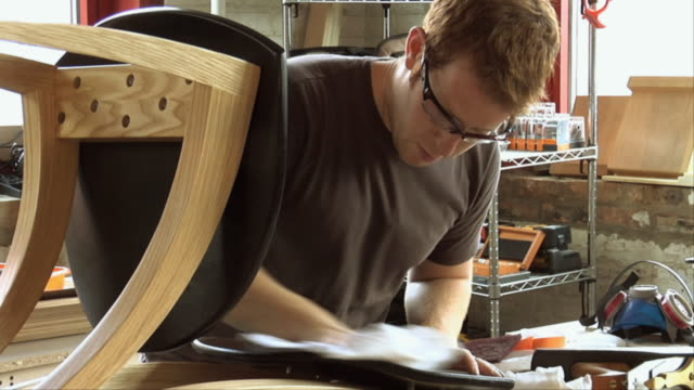 ms zo woodworker polishing chair back / chicago, illinois, usa - shelf stock videos & royalty-free footage