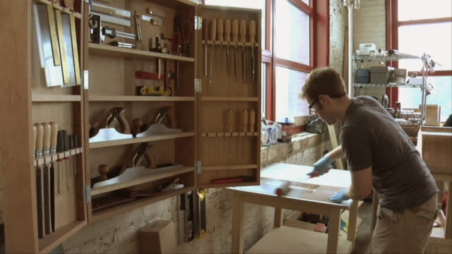 ms woodworker preparing veneer for application / chicago, illinois, usa - workbench stock videos & royalty-free footage