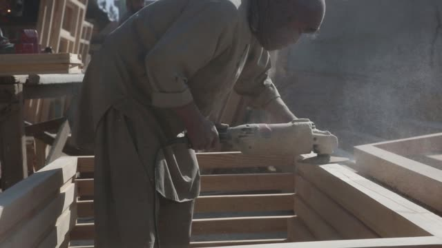 woodworkers build window casings and doors at a workshop in kabul afghanistan monday november 18 2017 photographer victor blue – shots shot of worker... - window frame stock videos and b-roll footage