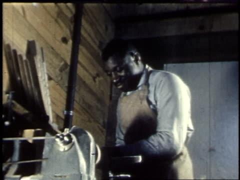 1940 MONTAGE Woodworking shop at Booker T Washington High School / Atlanta, Georgia, United States