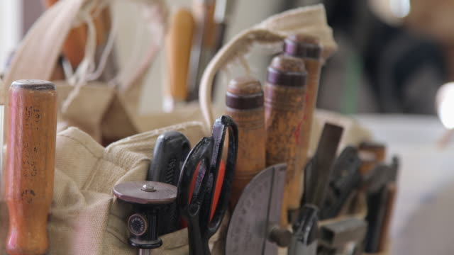cu woodworking tools in bag on workbench - workbench stock videos & royalty-free footage