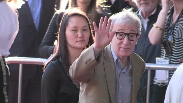 woody allen soon yi previn arrive at to rome with love in los angeles 06/14/12 woody allen soon yi previn arrive at to rome wit on june 14 2012 in... - woody allen stock videos & royalty-free footage