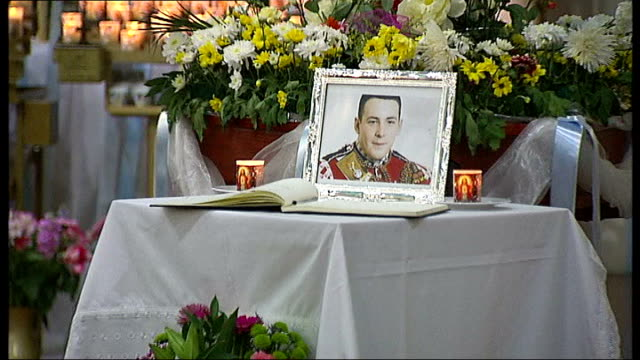 drummer lee rigby murder family leave tributes at scene st peter's church int **music heard sot** framed photograph of lee rigby on table next to... - lee rigby stock videos & royalty-free footage