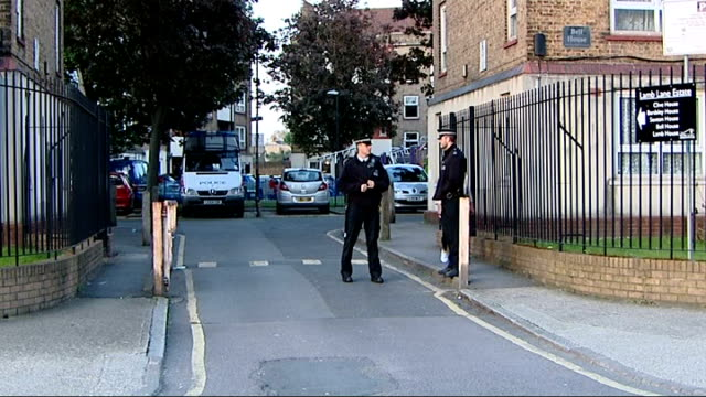 drummer lee rigby murder police make arrests 25513 greenwich police van at housing estate police on duty line of police along to van vox pops... - lee rigby stock videos & royalty-free footage