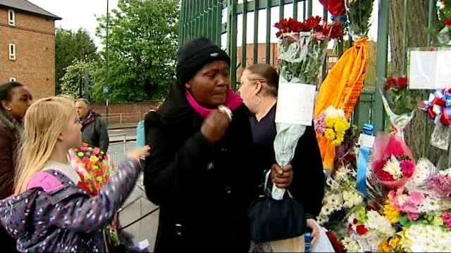 lee rigby family press conference london woolwich ext people laying flowers on pavement outside woolwich barracks photograph of lee rigby amongst... - lee rigby stock videos & royalty-free footage