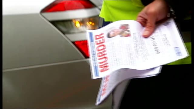 police make new appeal for information england london woolwich ext various of police officers handing out leaflets to passing motorists appealing for... - lee rigby stock videos & royalty-free footage