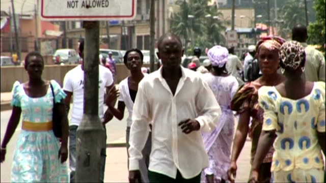 Reaction in Nigeria NIGERIA Lagos EXT People along street Road clogged with cars in big traffic jam Heavy traffic along street People up steps of...
