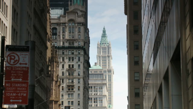 zo woolworth building taken from the street people is walking at day time / new york city, new york state, usa - woolworth building stock videos & royalty-free footage