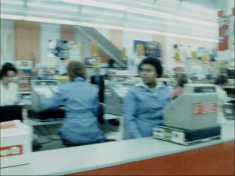 vídeos de stock, filmes e b-roll de woolworths announce drop in profits england london ext exterior of woolworths store cashier at till pan second one ms sign reading '2 pounds off'... - woolworths