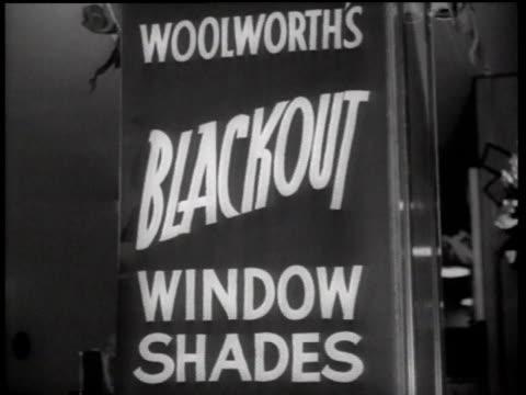 woolworth's sign advertising blackout window shades / new york city new york united states - 1942年点の映像素材/bロール