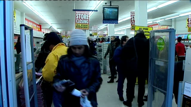 vídeos de stock, filmes e b-roll de woolworths stores close down / shoppers grab last minute bargains england ext shoppers in woolworths' store on final day of opening store closing... - woolworths