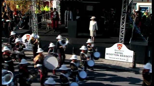wootton bassett bestowed with royal title; england: wiltshire: royal wootton bassett: ext close shot royal marines band along as playing sot band... - 英国海兵隊点の映像素材/bロール
