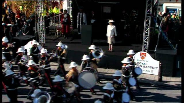 wootton bassett bestowed with royal title; various of royal marines marching band along as playing sot / sea cadets along in parade / anne watching... - royal marines stock videos & royalty-free footage