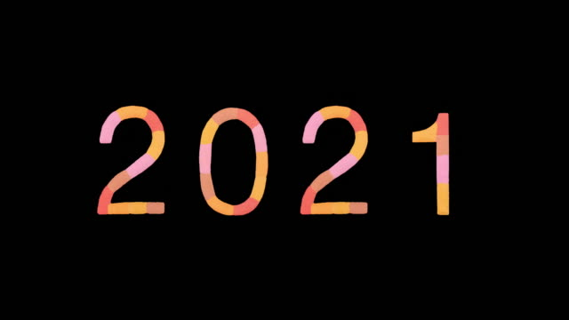 "word ""2021"" created with powder in warm colors exploding towards camera in super slow motion and closeup on black background - 形の変化点の映像素材/bロール"