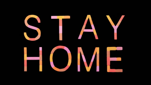 "word ""stay home"" created with powder in warm colors exploding towards camera in super slow motion and closeup on black background - positive emotion stock videos & royalty-free footage"