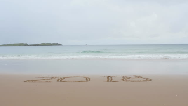 words 2018 on sandy beach,Northern Ireland