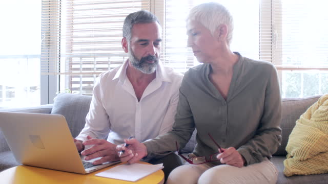 work and enjoy at home - mature couple stock videos & royalty-free footage