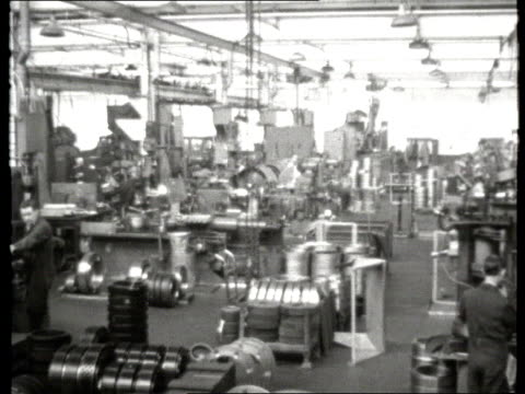 work and industry clip reel: part 1; tx 2.3.1962 heavy engineering: b/w general views inside simons engineering factory / lathe workers and drilling - b rolle stock-videos und b-roll-filmmaterial