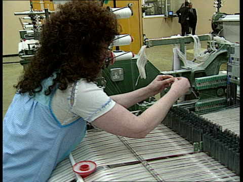 part 2 england lancashire burnley int textile mill as cotton is woven on looms / material off of loom / factory floor with employees working at... - textile mill stock videos & royalty-free footage