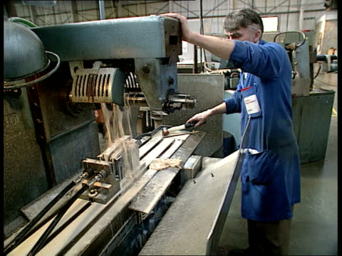 work and industry clip reel: part 2; location unknown: int rollls royce jet engine / men working on engines hertfordshire: hemel hempstead: lathe in... - micrometer stock videos & royalty-free footage