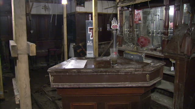 work begins to refurbish the bar that was destroyed after a police helicopter fell out of the sky in 2013 killing 10 people interior shots destroyed... - ヘリコプター事故点の映像素材/bロール