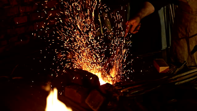 work : blacksmith working, flame and sparks. - blacksmith stock videos & royalty-free footage