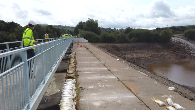 work continues at the whaley bridge dam site to shore up the damaged dam wall on august 21, 2019 in whaley bridge, england. approximately 1,500... - derbyshire stock videos & royalty-free footage