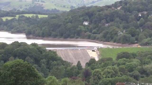 work continues to support the dam at toddbrook reservoir in whaley bridge thunderstorms threaten to bring more unwanted rainfall to the derbyshire... - weekend activities stock videos & royalty-free footage