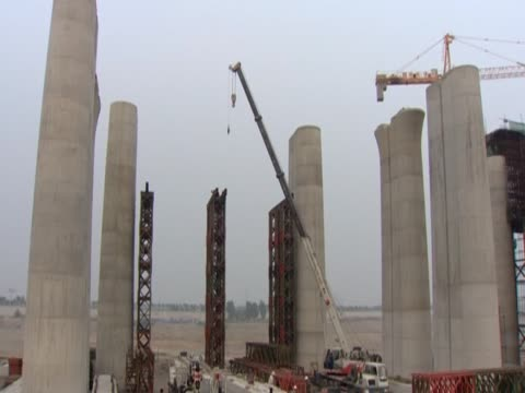 work going on at various building sites in china - variation stock videos & royalty-free footage