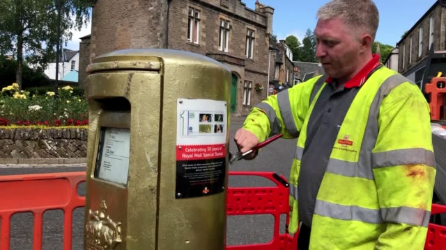 work has begun to reinstate a golden post box dedicated to sir andy murray after it was knocked over by a car. the post box has stood in dunblane... - gold medal stock videos & royalty-free footage