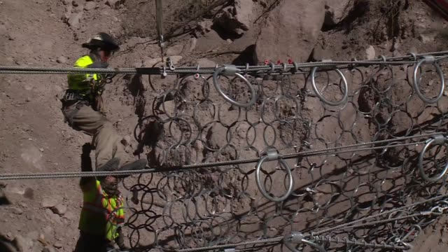 work men install wire fence to protect against sediment and debris following las conchas fire - puebloan peoples stock videos & royalty-free footage