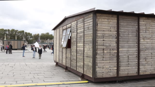work of art by artist jean prouvé called 'maison démontable 6x9 1946' and 'maison démontable 8x8 1944' is seen at the place de la concorde as part of... - installationskunst stock-videos und b-roll-filmmaterial