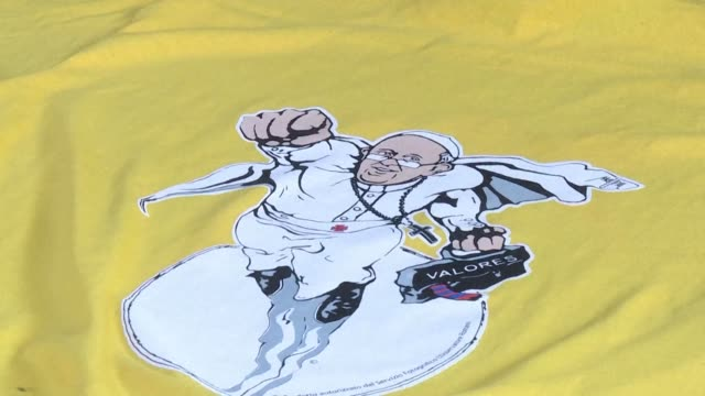 A work of street art that turned Pope Francis into superpope will now support Vatican charitable projects through the sale of tshirts bearing the...