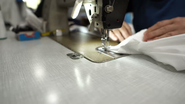 work on a sewing machine - shirt stock videos & royalty-free footage